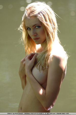 Adorable young blonde Erika E playing nude in and around a river