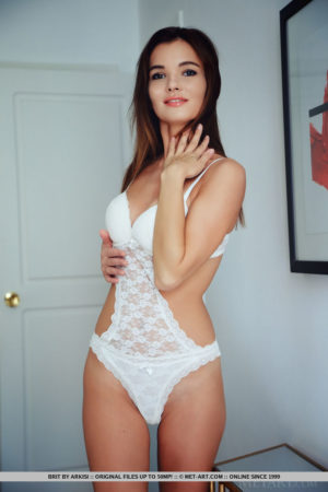 Cutie Brit flaunts her delicious puss as she strips her white lingerie on the bed
