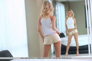 Blonde beauty Danica Jewels parades her perfect tits and sweet ass in front of the mirror