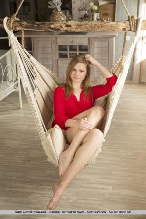 Isabela playfully poses on the swing baring her creamy, nubile body