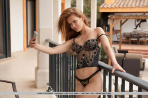 Laina strips her sexy lingerie on the balcony baring her lusty body
