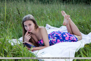 Frech faced Lara Sugar removes her dress on the picnic blanket to be naked