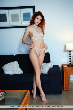 Redhead Adel C taking off her panties and bra to spread her sexy legs