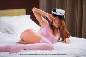 Redhead Michelle H bares her lusty body as she strips on the bed