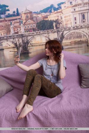 Redhead Renzi takes selfies as she gets nude on the sofa