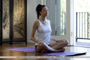 Exotic Scarlett Bloom displays her sexy body while doing yoga