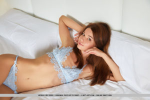 Nedda A displays her delectable pussy as she strips her two-piece lingerie on the bed