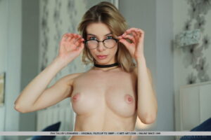 Gorgeous girl in glasses Eva Tali plays her seductive fantasy on the bed