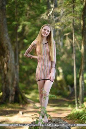 Fair skinned coed Lena Flora gets fully naked outside in the forest